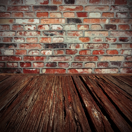 grungy background: brick wall and wood floor background of old cellar
