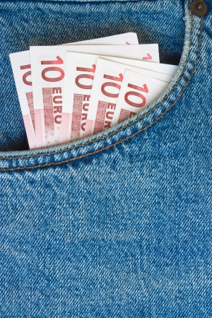 euro banknotes in jeans pocket with blank background for text photo