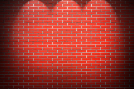 red brick: red brick wall background with beams of light Stock Photo