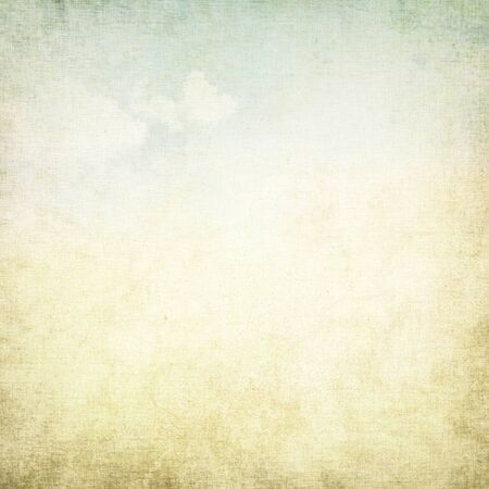 old paper grunge background with delicate abstract canvas texture and blue sky view Stock Photo