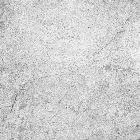 in stone: white wall texture old dirty scratched plaster as grunge background