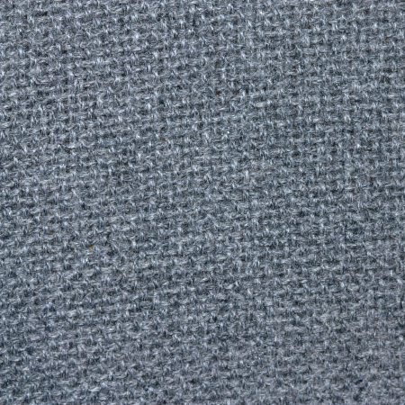 old grey thick fabric texture background, natural wool upholstery closeup photo