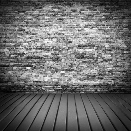 theatrical: dark brick wall texture in basement house interior with beam of light and wooden floor, may use as grunge halloween background or night club advertising