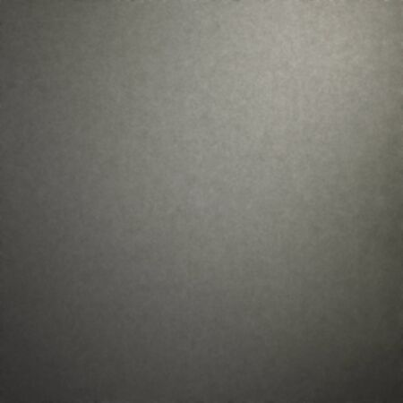 dark grey felt fabric texture background with delicate beam of light and vignette