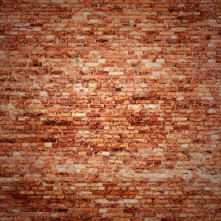red brick wall texture grunge background with vignetted corners of interior photo