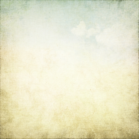 old parchment grunge background with delicate abstract canvas texture, white clouds and blue sky view photo