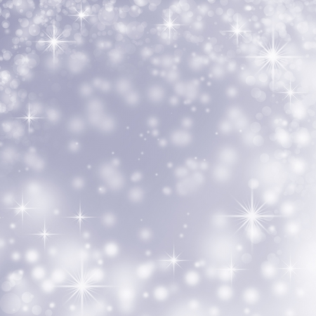 white christmas lights on blue abstract background with delicate stars, snowflakes, sparkles and subtle bokeh bubbles photo