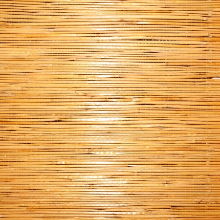 straw background texture, mat with delicate beam of light photo