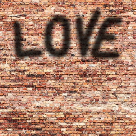 red brick wall texture and shadow painted love text as valentine day background photo