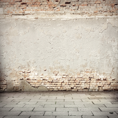 stone wall: white grunge background, red brick wall texture bright plaster and blocks road sidewalk urban background Stock Photo