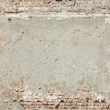 old wall texture background red bricks and cement plaster photo