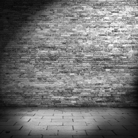 brick wall: dark brick wall background in basement with beam of light