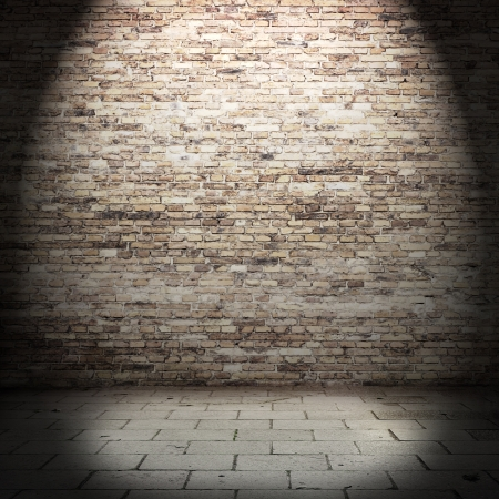 red brick wall background in basement with beam of light photo