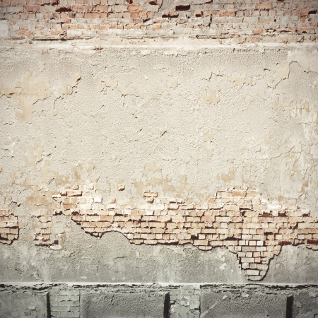 abandoned: white plastered wall and brick wall texture grunge background