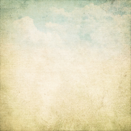 old parchment paper grunge background with canvas texture and delicate blue sky and white clouds painting photo