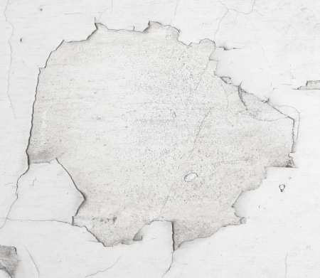 white torn paper edge and gray hole wall texture inside photo