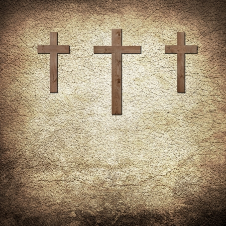 three wooden crosses on the old brown leather background photo