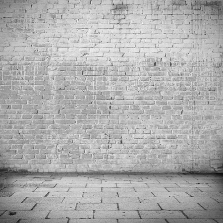antique factory: grunge background white brick wall texture and blocks road sidewalk abandoned building exterior urban background for your concept or project