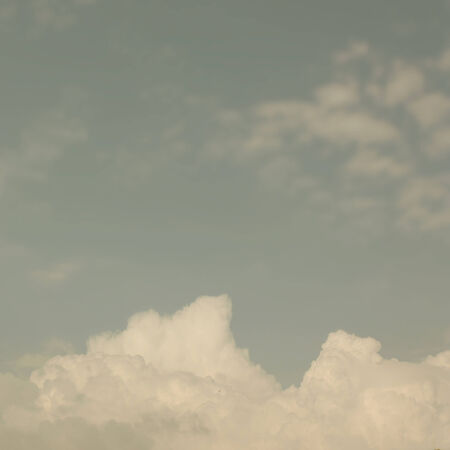 pale colours: vintage background white clouds on pale blue sky Stock Photo