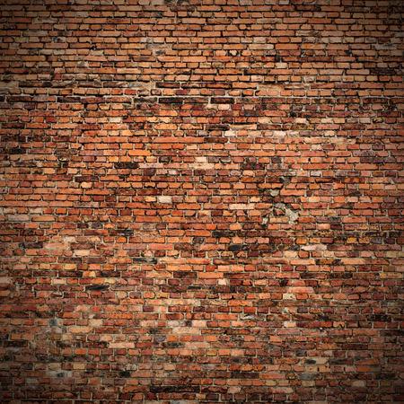 インテリア ・ デザインに赤レンガの壁の角の vignetted テクスチャ グランジ背景