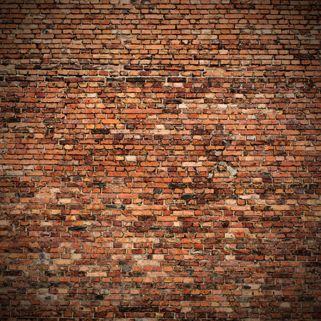 old brick wall: red brick wall texture grunge background with vignetted corners to interior design