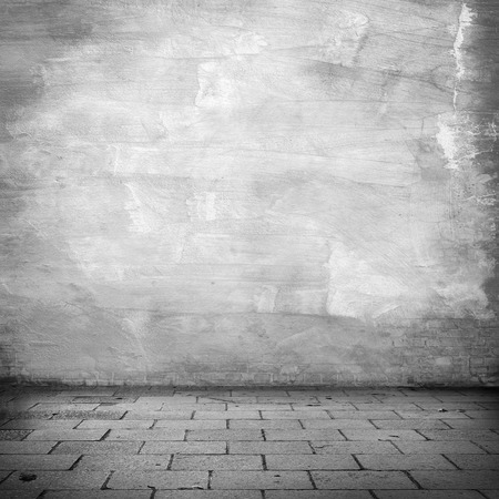 exterior wall: grunge background, white plaster wall texture gray sidewalk abandoned warehouse exterior urban background for your concept or project