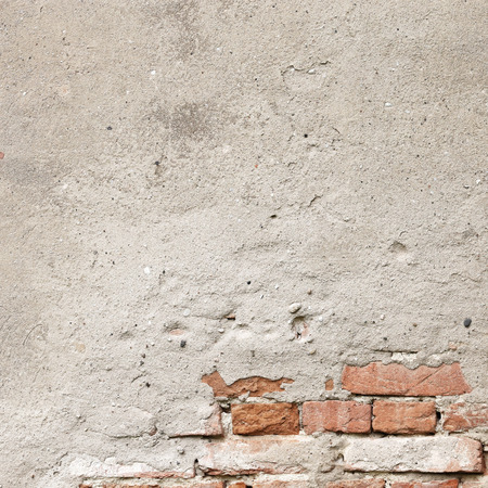 grunge background, wall texture, bright plaster and red bricks photo