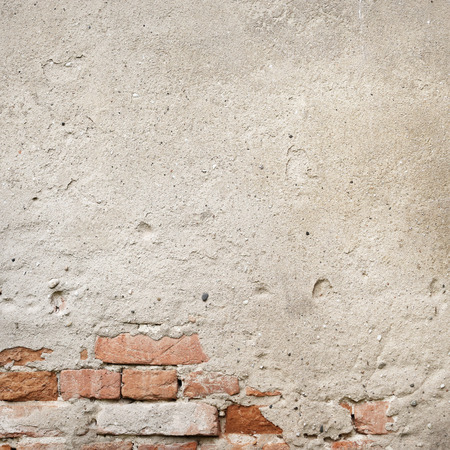 old wall texture grunge background bright plaster and red bricks photo
