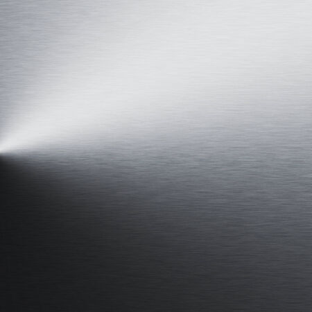 alluminum: silver metal background, chrome texture and beam of spot light