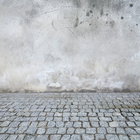 grunge urban background, old wall texture bright plaster and blocks road sidewalk abandoned exterior urban background for your concept or project photo