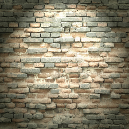 brick wall texture background in basement with beam of light photo