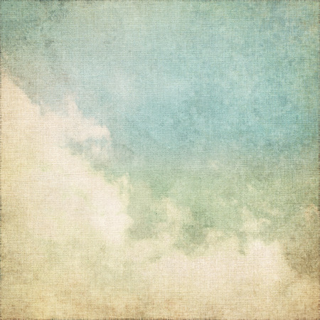 grunge background old canvas paper parchment texture with blue sky and white clouds abstract scenery Stock Photo