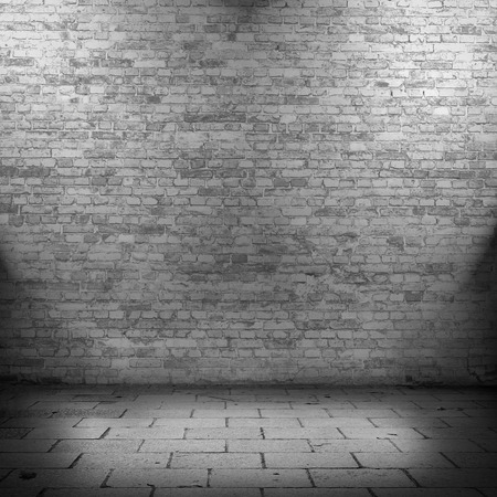abandoned building: brick wall texture background and beams of lights, black and white