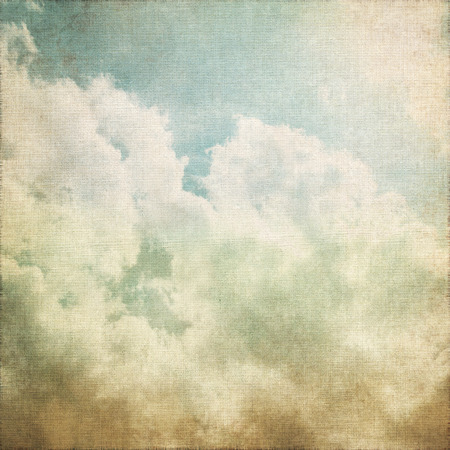 grunge background old canvas paper texture white clouds on blue sky abstract scenery vintage painting photo