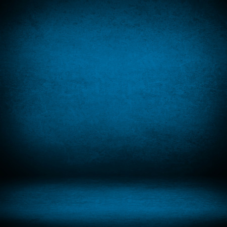 interior wall background suede paper texture in blue color and shadow vignette in the corners photo