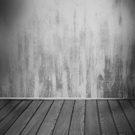 interior background, old painted grunge wall texture and wooden floor in black and white photo
