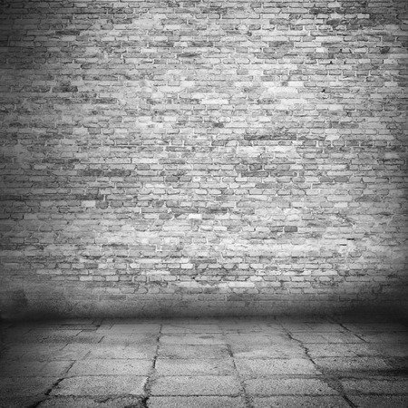 urban background, brick wall texture and sidewalk in black and white photo