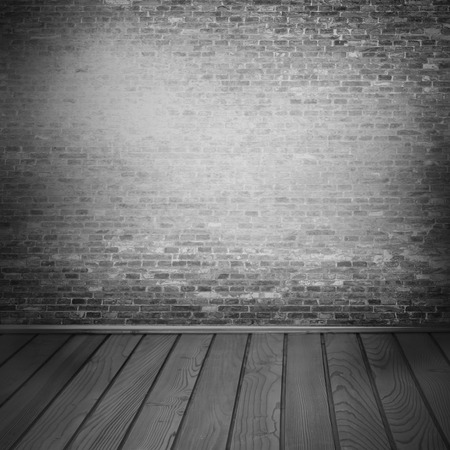 interior background, brick wall texture and tiled wooden floor in black and white photo