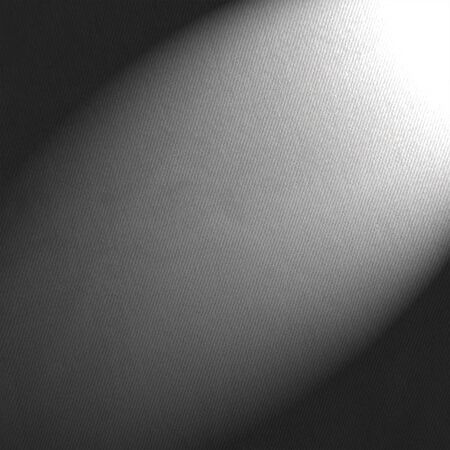 background canvas: black and white background canvas paper and beam of spot light Stock Photo