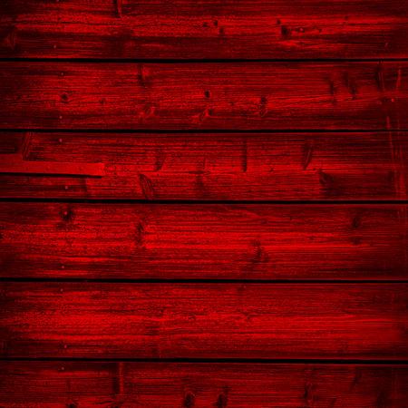 濃い赤の背景の木板のテクスチャ