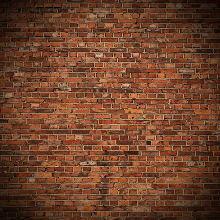 brick wall: red brick wall texture grunge background with vignetted corners to interior design