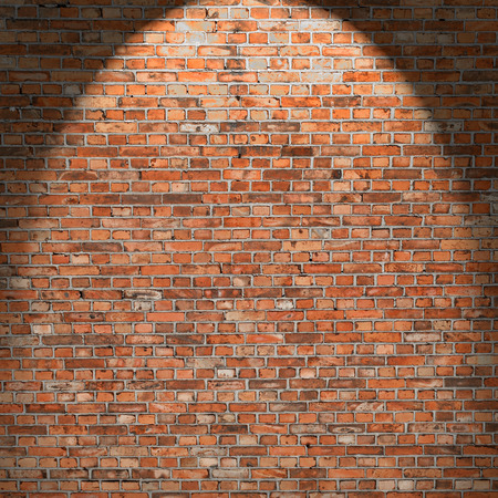 spot light: red brick wall texture, interior grunge background with beam of spot light