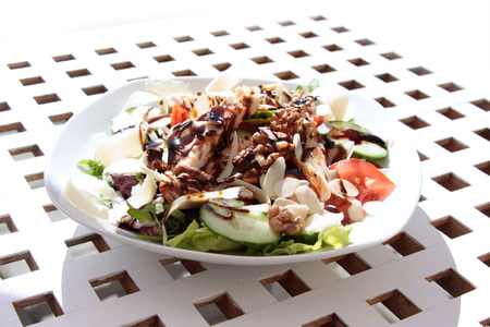 side order: side dish on white plate, grilled chicken and salad Stock Photo