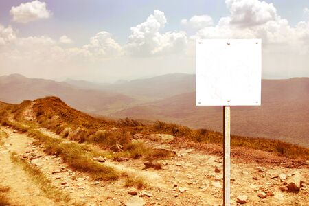 alpine zone: blank signboard on the mountain landscape background