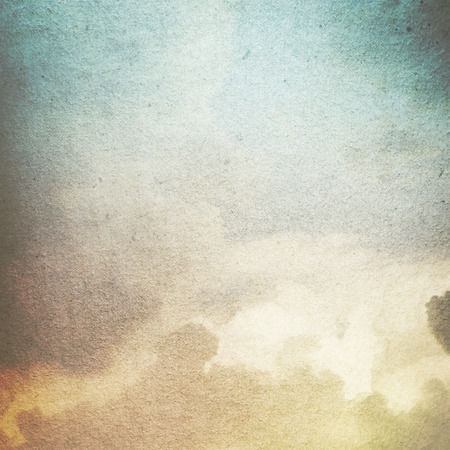 old paper grunge background with abstract canvas texture white clouds and blue sky view Stock Photo