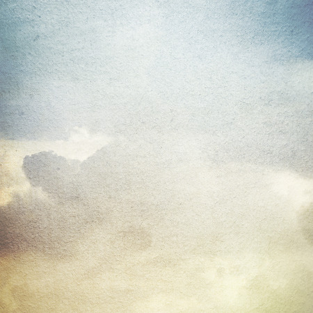 white color: old paper grunge background with abstract canvas texture white clouds and blue sky view Stock Photo