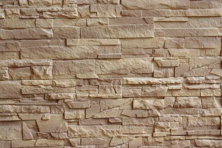 ベージュのレンガの壁のテクスチャ背景