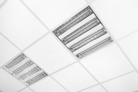 grids: fluorescent lamp lights on the white modern ceiling