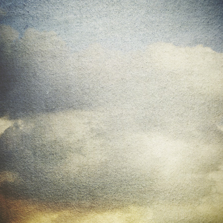old paper: grunge background old view of blue clouds on blue sky abstract background old canvas paper texture no frame vintage painting