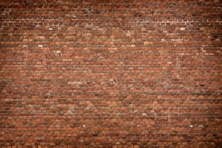 brick facades: red brick wall texture grunge background with vignetted corners, may use to interior design